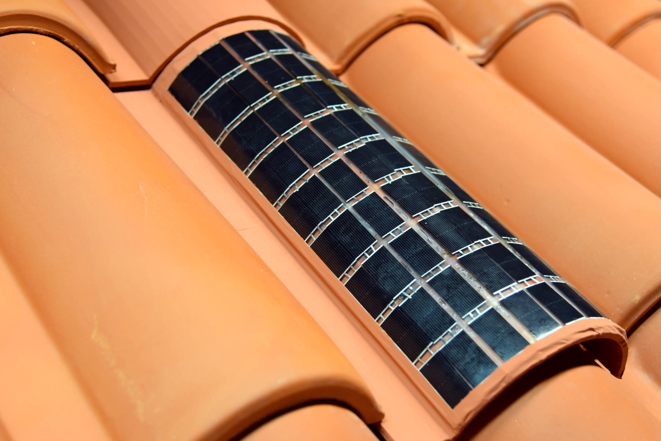 Prototype SmartPVSkin roofing tile using a pixelated array of solar cells.