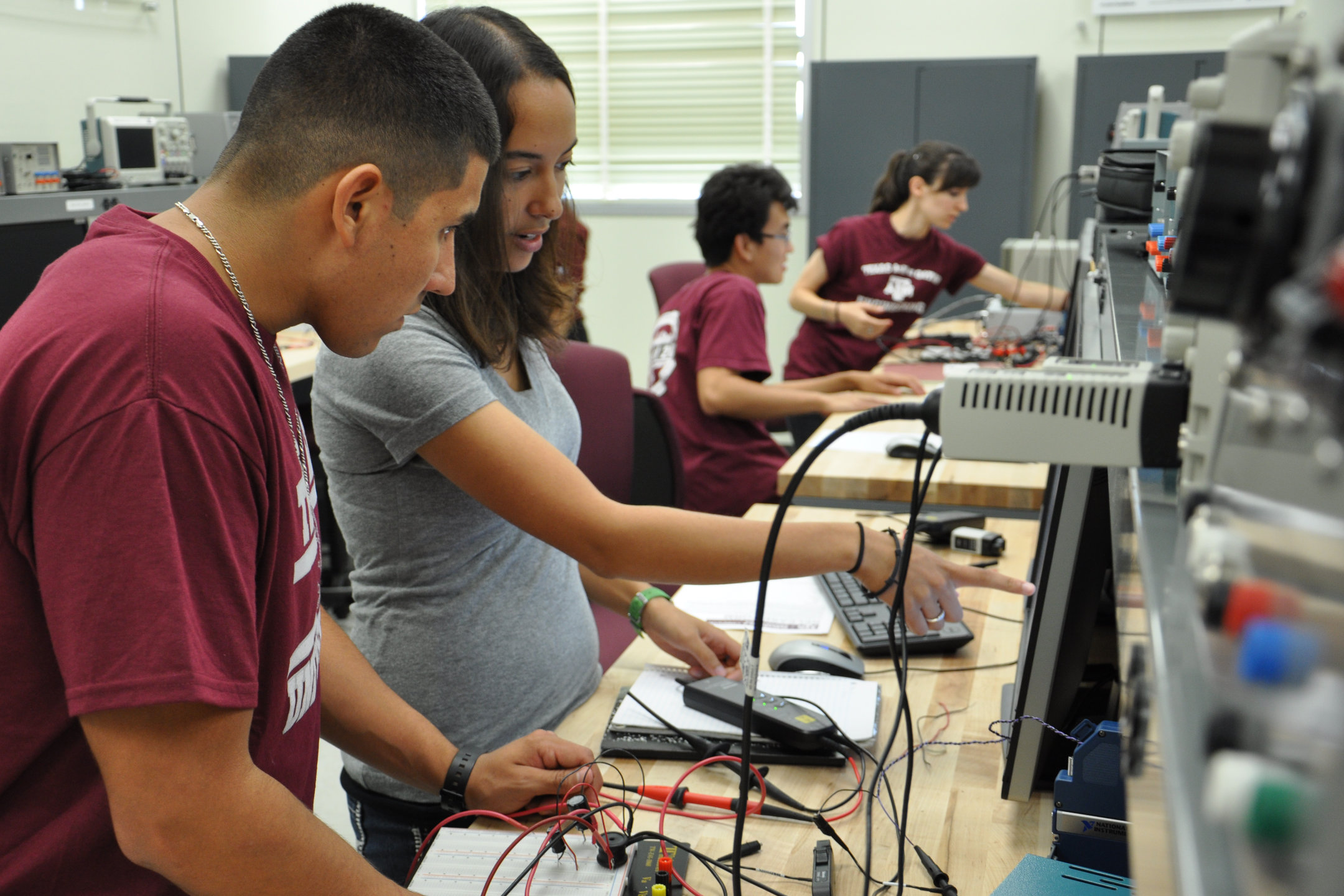 Student researchers conduct an experiment in REAPER Lab's College Station facility.